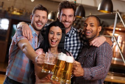 14821378-group-of-happy-young-friends-drinking-beer-at-pub-laughing-clinking-glasses